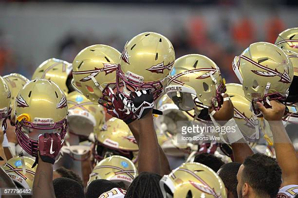 Florida State Seminoles team in a huddled waving their helmets in the air during the Cowboys Classic Florida State at Oklahoma State at ATT Stadium...