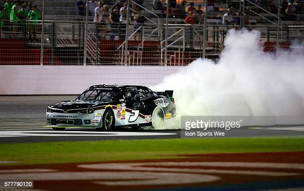 Kevin Harvick celebrates winning the Great Clips 300 with a burnout at the Atlanta Motor Speedway in Hampton, GA.