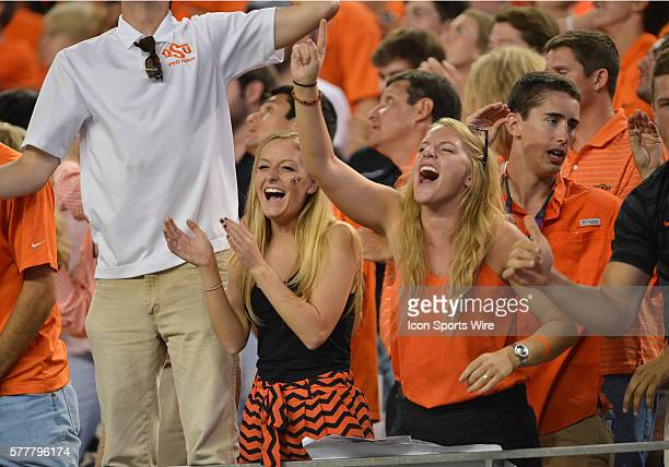 Oklahoma State Cowboys fans cheering for their team during the Cowboys Classic Florida State at Oklahoma State at ATT Stadium in Arlington Texas...