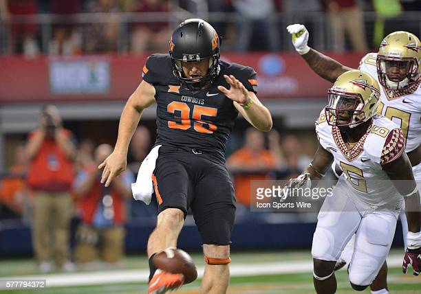 Oklahoma State Cowboys punter Kip Smith miss the catch and kicks the ball during the Cowboys Classic Florida State at Oklahoma State at ATT Stadium...