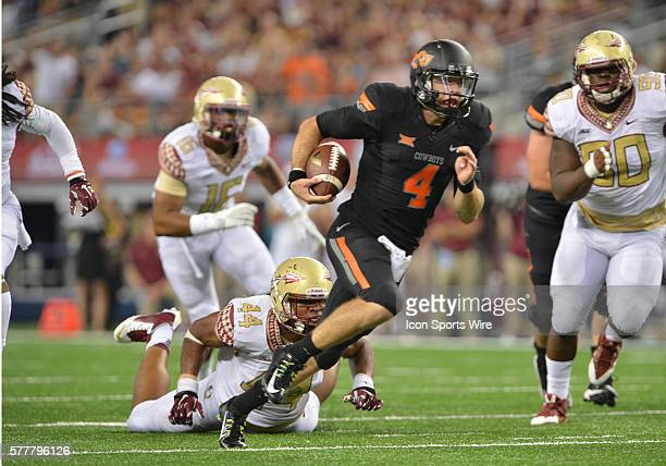 Oklahoma State Cowboys quarterback JW Walsh carries the ball during the Cowboys Classic Florida State at Oklahoma State at ATT Stadium in Arlington...