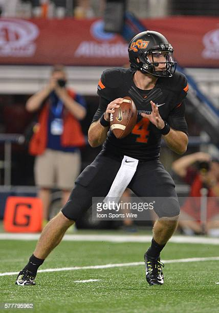 Oklahoma State Cowboys quarterback JW Walsh looking for receivers during the Cowboys Classic Florida State at Oklahoma State at ATT Stadium in...