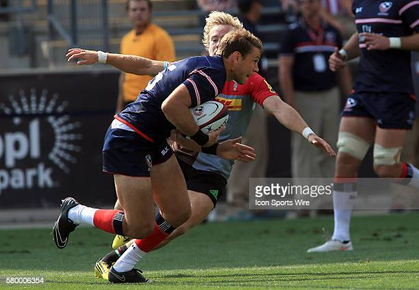Blaine Scully of the USA Eagles bursts past Charlie Walker of Harlequins during an international rugby friendly match at PPL Park in Chester PA...