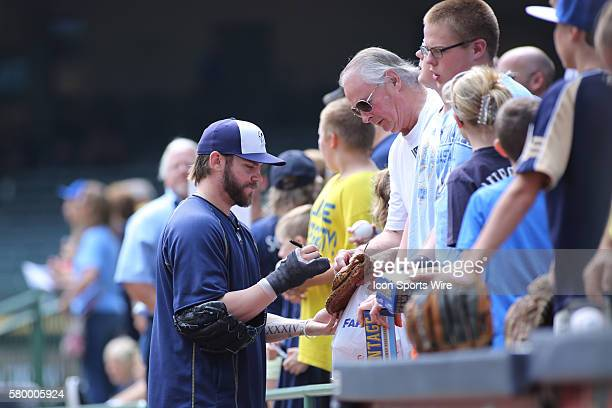Milwaukee Brewers Pitcher Michael Blazek signs autographs for fans prior to the Cincinnati Reds game versus the Milwaukee Brewers at Miller Park in...