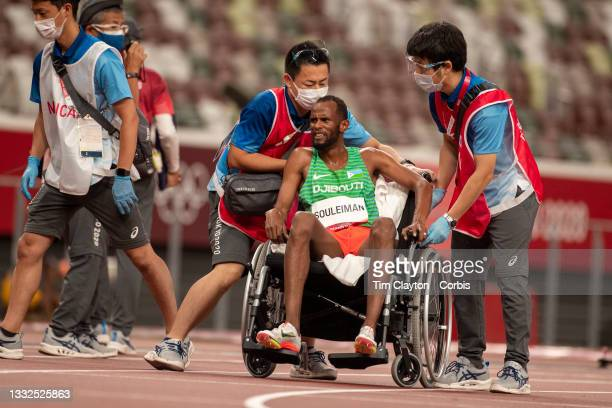 August 5: Ayanleh Souleiman of Djibouti after injuring himself during the 1500m semi final during the Track and Field competition at the Olympic...