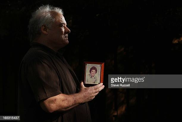 """August 6, 2010 Ted Holland holds his grade 13 picture from St. Charles College. Ted Holland was allegedly molested by Fr. William """"Hodgson"""" Marshall..."""