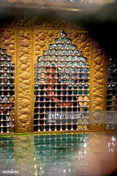 August 6 Mir Movsum Agha Sanctuary, Shuvelan, Baku, Azerbaijan. A Muslim woman visits Mir Movsum Agha, the most important sanctuary in all of...