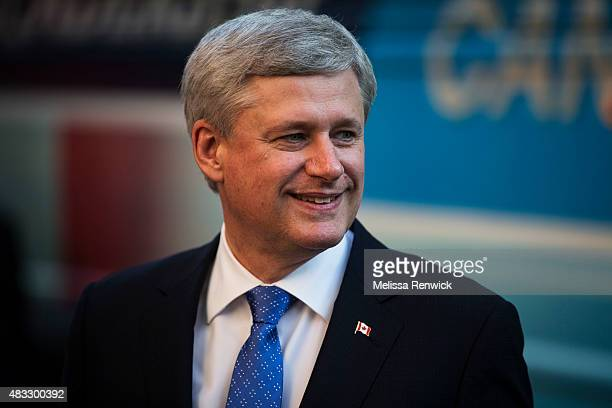 TORONTO ON August 6 Stephen Harper steps off of his bus before he faces off NDP Leader Thomas Mulcair Liberal Leader Justin Trudeau and Green party...