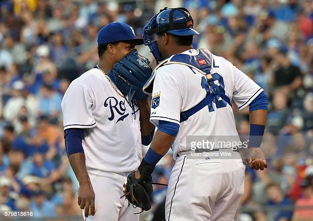 Kansas City Royals' catcher Salvador Perez talks with Kansas City Royals' starting pitcher Edinson Volquez during a Major League Baseball game...