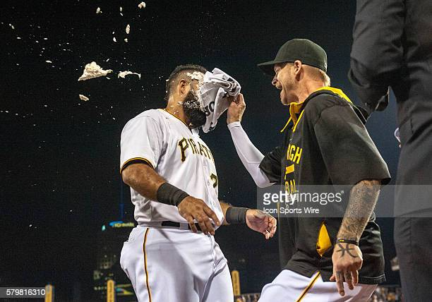 Pittsburgh Pirates first baseman Pedro Alvarez is hit with a whipped cream pie by starting pitcher AJ Burnett after hitting a walkoff single to lead...