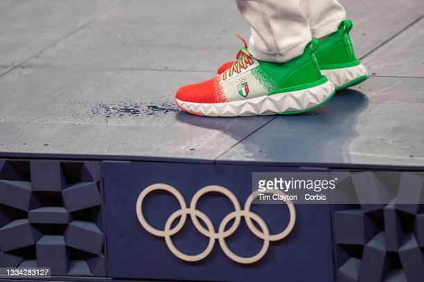 August 7: Antonella Palmisano of Italy on the podium receiving her gold medal for winning the 20km walk for women during the Track and Field...