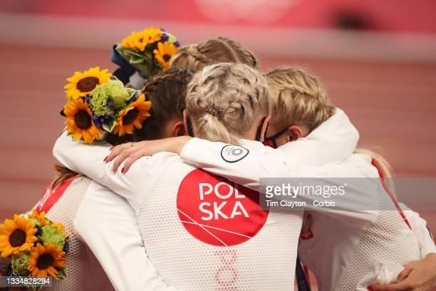 August 7: Natalia Kaczmarek, Iga Baumgart-Witan, Malgorzata Holub-Kowalik and Justyna Swiety-Ersetic of Poland on the podium after winning the silver...