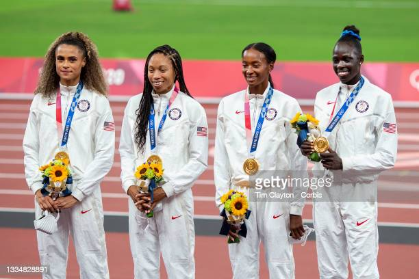 August 7: Sydney McLaughlin,, Allyson Felix, Dalilah Muhammad and Athing Mu of the United States on the podium after winning the gold medal in the 4x...