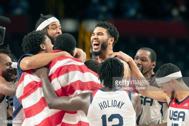 August 7: The United States team celebrate their gold medal win during the France V USA basketball final for men at the Saitama Super Arena during...