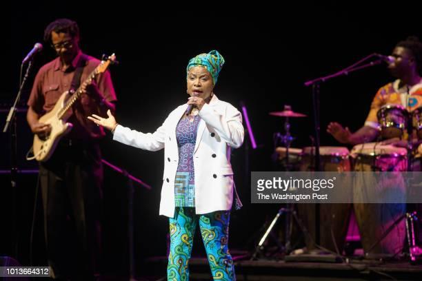 VIENNA VA August 7th 2018 Grammy Awardwinning Beninese singersongwriter Angélique Kidjo perform with guitarist Dominic James and percussionist...