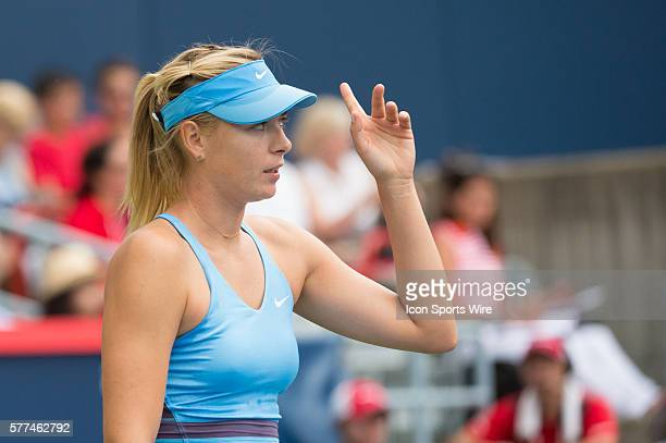 August 7th Tennis player Maria Sharapova challenges a call in match against Carla Suarez Navarro in the second round at the Rogers Cup tournament at...