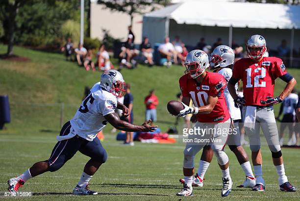 New England Patriots quarterback Jimmy Garoppolo hands off to New England Patriots running back Jonas Gray during New England Patriots training camp