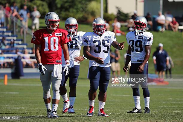 New England Patriots quarterback Jimmy Garoppolo waits with New England Patriots running back Brandon Bolden New England Patriots running back Jonas...
