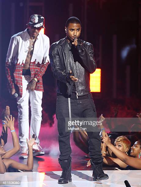 August Alsina and Trey Songz perform onstage during the BET AWARDS 14 held at Nokia Theater LA LIVE on June 29 2014 in Los Angeles California