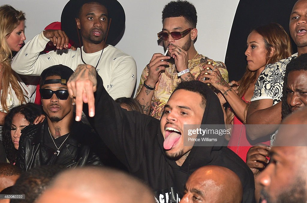 August Alsina, Chris Brown and Karreuche Tran attend playhouse on June 29, 2014 in Los Angeles, California.