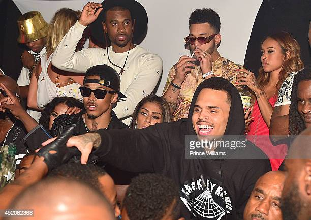 August Alsina Chris Brown and Karreuche Tran attend playhouse on June 29 2014 in Los Angeles California