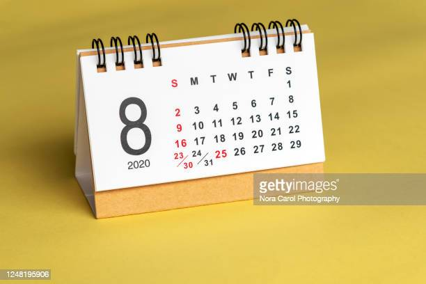 august calendar on yellow background - august stock pictures, royalty-free photos & images