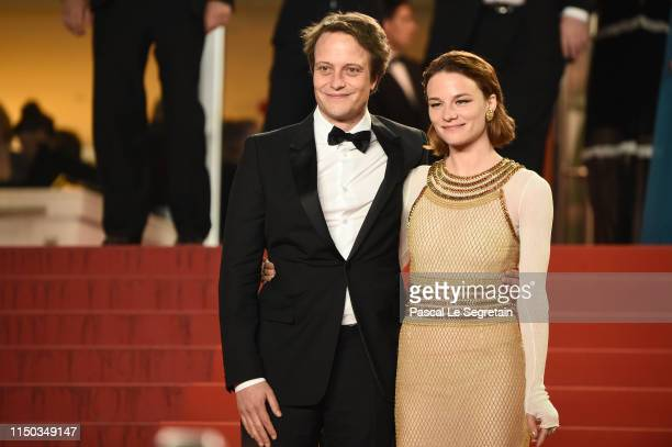 August Diehl and Valerie Pachner depart the screening of A Hidden Life during the 72nd annual Cannes Film Festival on May 19 2019 in Cannes France
