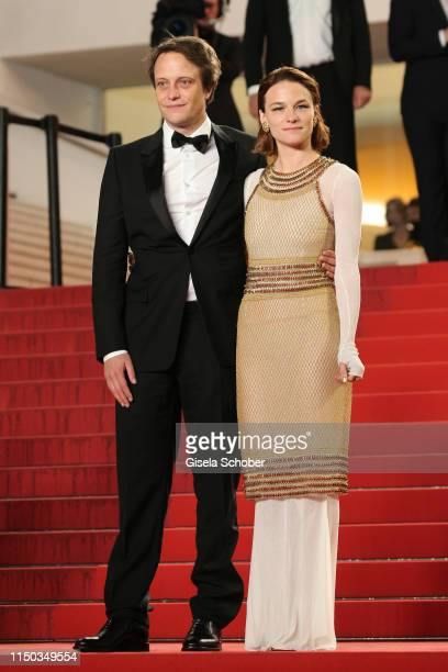 August Diehl and Valerie Pachner leave the screening of A Hidden Life during the 72nd annual Cannes Film Festival on May 19 2019 in Cannes France