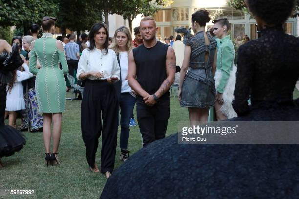 August Getty and Emmanuelle Alt are seen at the August Getty Fall/Winter 2019 2020 presentation as part of Paris Fashion Week on July 03 2019 in...