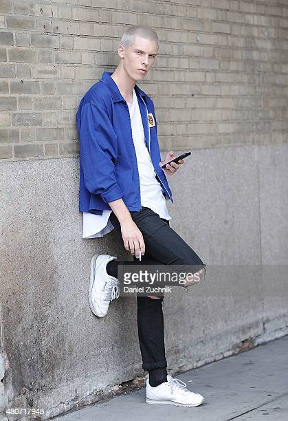 August Gonet is seen outside the Duckie Brown show wearing a vintage jacket Levis jeans and classic Reebok sneakers during New York Fashion Week...