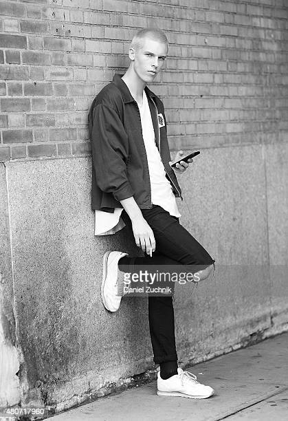 August Gonet is seen outside the Duckie Brown show wearing a vintage jacket during New York Fashion Week Men's S/S 2016 at Skylight Clarkson Sq on...