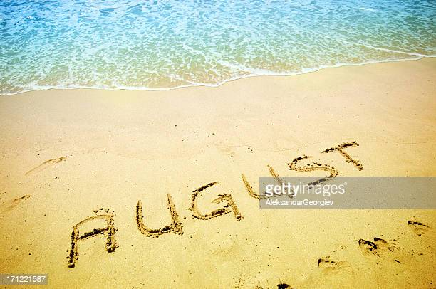 august handwritten in the sandy shoreline - august stock pictures, royalty-free photos & images