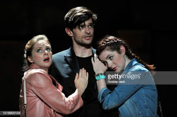 Kate Batter as Polly Peachum Benjamin Purkiss as Macheath and Olivia Brereton as Lucy Lockit in Theatre des Bouffes du Nord's production of Ian...