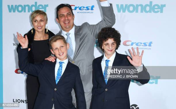 August Pullman on whom the story is based waves on arrival with his family for the world premiere of the film 'Wonder' in Los Angeles California on...