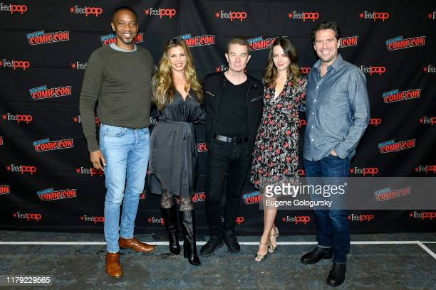 August Richards, Charisma Carpenter, James Marsters, Amy Acker, and Alexis Denisof attend the press line at the Angel - 20th Anniversary panel during...
