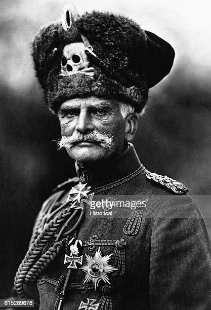 August von Mackensen a German Field Marshal during World War I wears a fur hat with a skull embedded in it Iron Crosses decorate his uniform