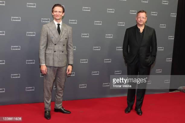 """August Wittgenstein and Matthias Brandt attend the """"Das Geheimnis des Totenwaldes"""" premiere during Hamburg film festival on September 30, 2020 in..."""