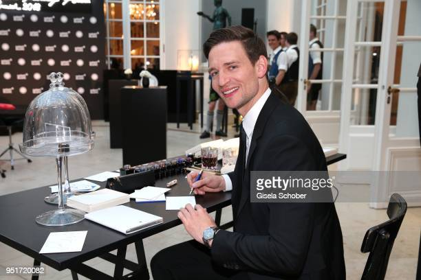 August Wittgenstein Brand Ambassador Montblanc writes with a filler during the 27th Montblanc de la Culture Arts Patronage Award at Residenz on April...