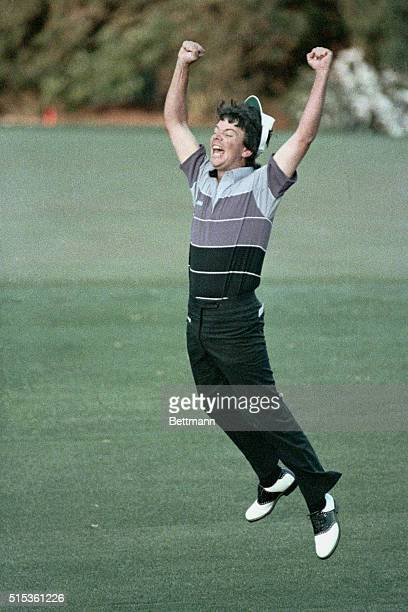 Augusta, GA- Larry Mize jumps high in the air after sinking a breathtaking 40-yard chip shot during second hole of sudden death to win the Masters...