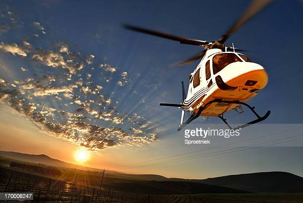 Augusta helicopter lit by setting sun