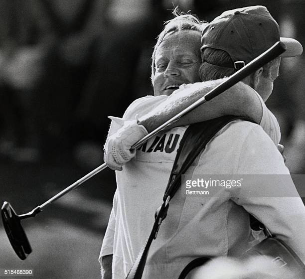 Jack Nicklaus is hugged by his son Jack Jr who is also his caddy after Nicklaus finished his final round of the Masters April 13th Nicklaus won with...
