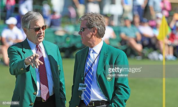 Augusta National chairman Billy Payne and competition committee chairman Fred Ridley look over the 18th green during a practice round prior to the...