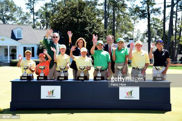 Augusta National Golf Club Chairman Billy Payne USGA President Diana Murphy and PGA President Paul Levy pose for a photo with the overall winners...