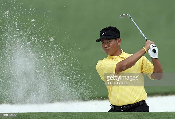 KJ Choi of Korea hits out of the sand trap on the second hole at the Augusta National Golf Club 04 April 2007 for the 71st Masters Golf Tournament in...