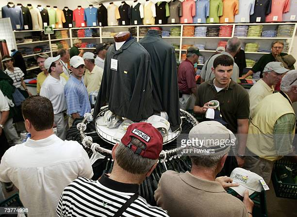 Patrons look over merchandise at the gift shop at the Augusta National Golf Club 02 April 2007 during the first practice round for the 71st Masters...