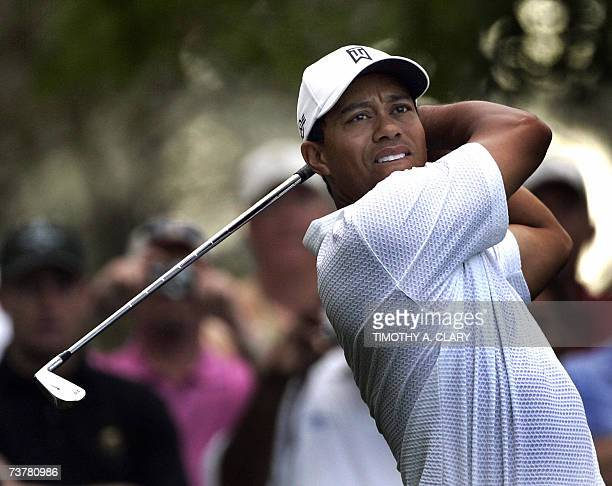 Augusta, UNITED STATES: Tiger Woods of the United States hits his tee shot on the 4th hole 03 April, 2007 during the second practice round for the...