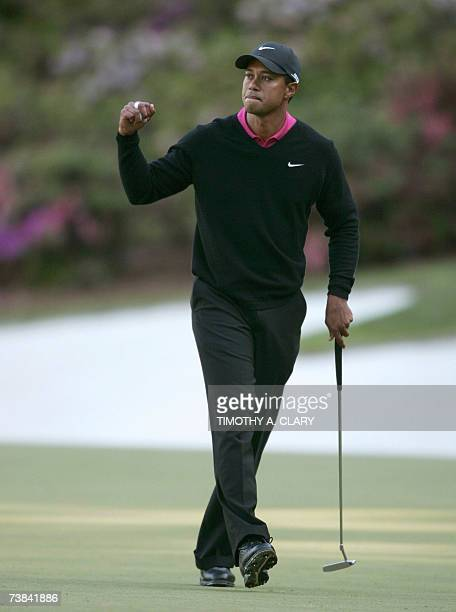 Tiger Woods of the US celebrates an eagle on the 13th hole 08 April 2007 during the final round at the 71st Masters Golf Tournament in Augusta...
