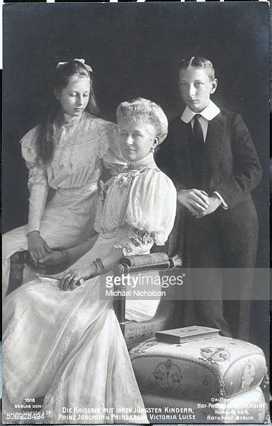 Augusta Victoria the Empress of Prussia and Germany poses with her two youngest children Princess Victoria Louise and Prince Joachim