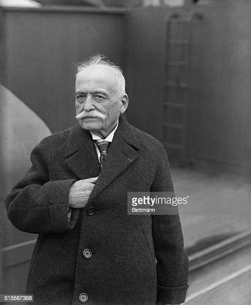 Auguste Escoffier French chef at various first class hotels is shown standing on a ship as it arrives in New York