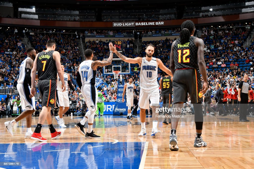 D.J. Augustin #14 and Evan Fournier #10 of the Orlando Magic react against the Atlanta Hawks on December 6, 2017 at Amway Center in Orlando, Florida.